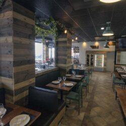 Parte del salón polivalente donde las mesas se puede unir para albergar grupos. Restaurante Bovino Gijón.